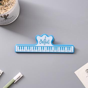 音楽の文具のクリップの大きいスペクトルは音符を挟んで楽譜を挟んで鍵盤のフォルダのピアノのプラスチックの大きいクリップの青色を挟みます。